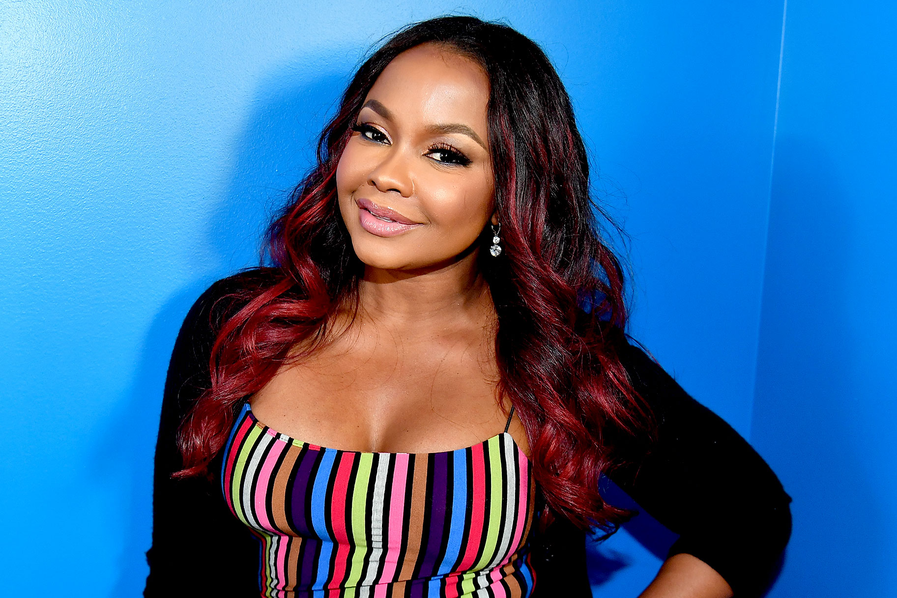 Phaedra Parks wears cheetah cut-out swimsuit