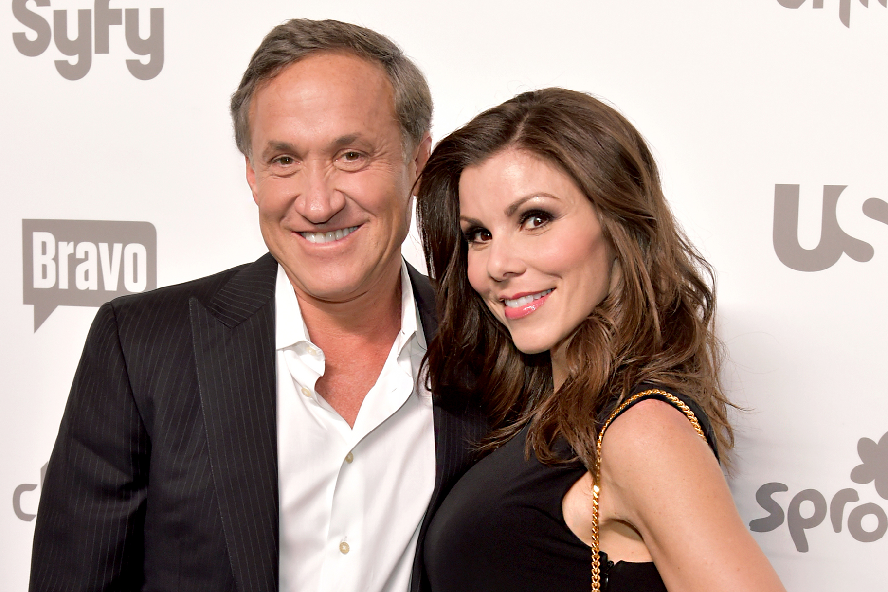 Heather Dubrow with clever, Husband Terry Dubrow