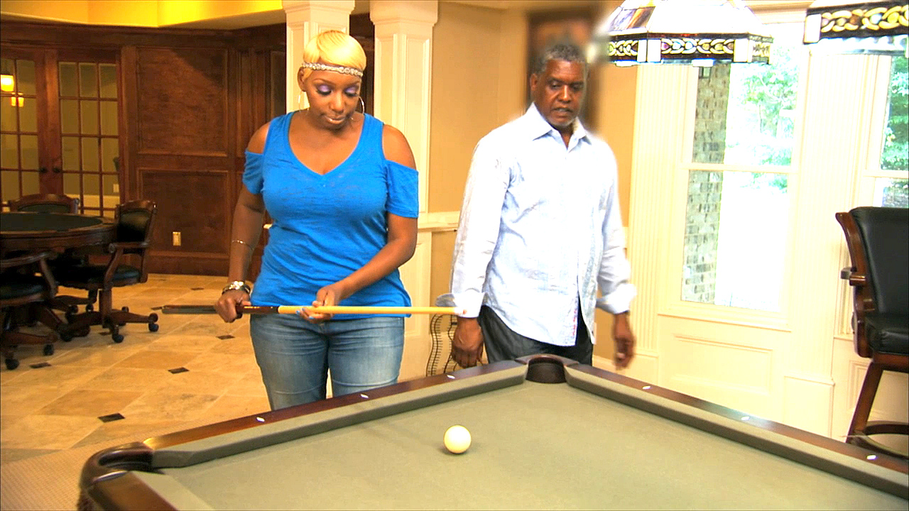 Why is NeNe Playing Pool?