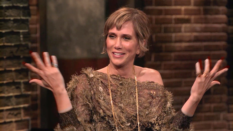 Why Did Kristen Wiig Carry Around an Empty Guitar Case?
