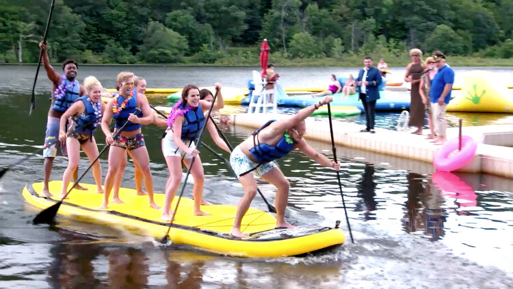 Team Counselors Dominate This Paddle Board Race Against Team Campers