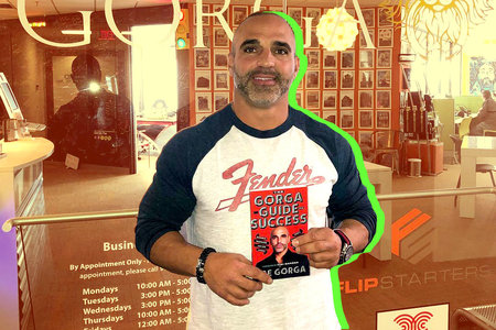 Joe Gorga with his book The Gorga Guide to Success