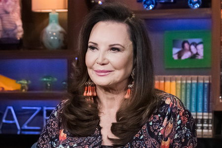 Patricia Altschul Wears a Black One-Piece Swimsuit on a Flamingo Float