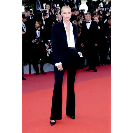 1de95494958a6 Charlize paired her Dior Couture smoking jacket with a pulled-back bun