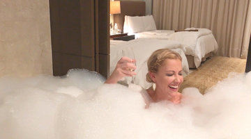 Stephanie Hollman Drinking Champs in a Bathtub