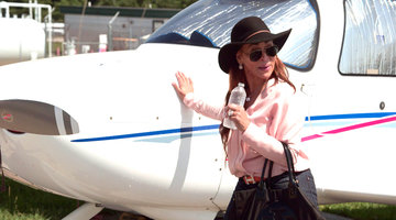 Karen Huger Blesses a Plane With Holy Water From Her Purse