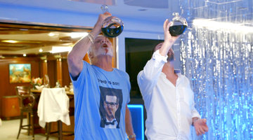 Captain Lee Chugs Red Wine While Wearing a T-Shirt With a Charter Guest's Face On It