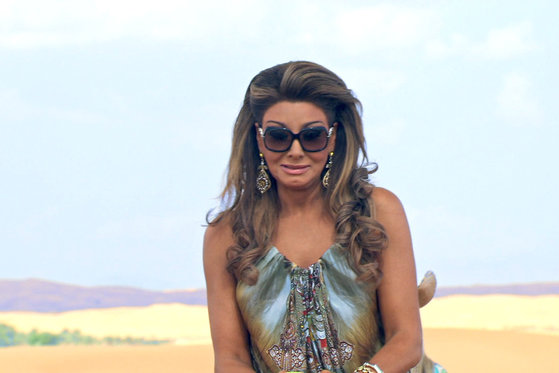 Gina Liano Rides a Camel...Kind Of