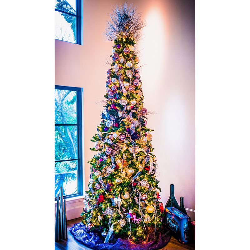 Next topic of discussion: that tree topper! Eschewing your standard star or angel, Cary instead opted to create a crown-like topper full of wiry, ...