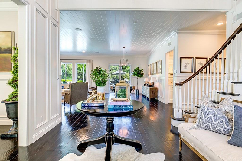 A Welcome Way To Be Greeted Into This 4,600 Square Foot Open Floor Plan Home,  Which Has Custom Woodwork, Dark Hardwood Floors, And Lighting By  Restoration ...